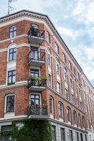 Facade of red brick Building with Balconies, Copenhagen