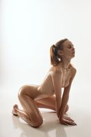 Nude beautiful woman staying on her knees