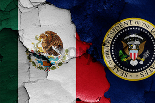 flags of Mexico and President of the United States painted on cracked wall