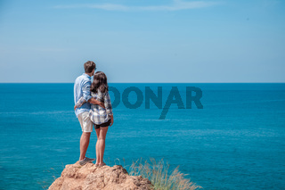 Young couple look at sea