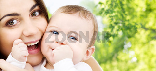 mother with baby over green natural background