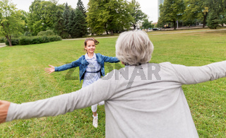 grandmother and granddaughter playing at park
