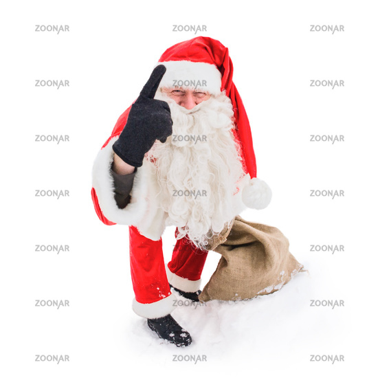 Santa Claus pointing with his index finger up. Isolated on white background.