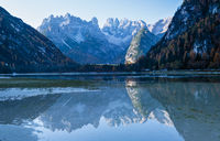 Autumn peaceful alpine lake Durrensee or Lago di Landro. Snow-capped Cristallo rocky mountain group behind, Dolomites, Italy, Europe. Seasonal and nature beauty concept. People and cars unrecognizable