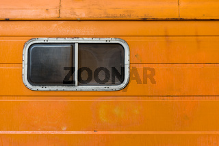 The orange old caravan with the plastic window