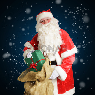 Smiling Santa Claus delivers gifts in a big brown bag