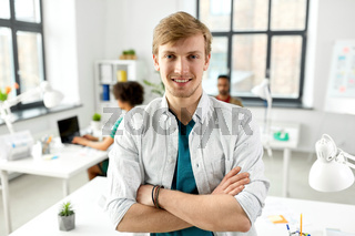 man with crossed hands at office