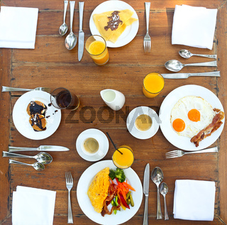 Continental breakfast with pancakes, eggs, bacon, orange jiuce and coffee