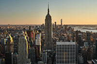 Skyline of New York city with the Empire State Building at sunset