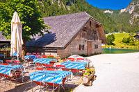 Konigssee coast Bavarian Alpine landscape and old wooden architecture view