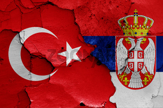 flags of Turkey and Serbia painted on cracked wall