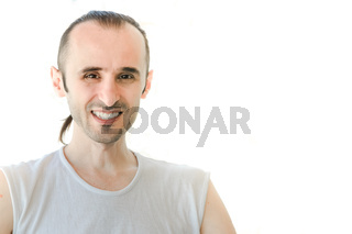 Happy brunet man with white shirt smiling on white background
