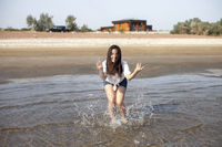 Woman splashing in a sea