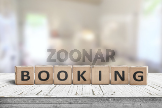 Booking sign on a wooden desk in a room