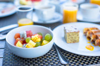 Fresh fruit salad, waffles, cake, coffee and juice served for breakfast at resort restaurant