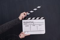 movie clapper on balck chalkboard background