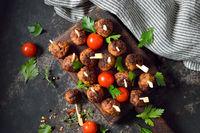 Spicy meatballs on skewers