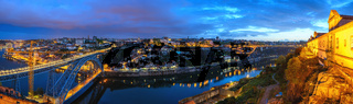 Porto Portugal night panorama city skyline at Porto Ribeira with Douro River and Dom Luis I Bridge