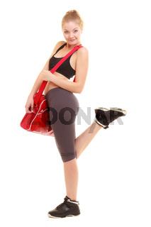 Sport. Fitness sporty girl in sportswear with gym bag