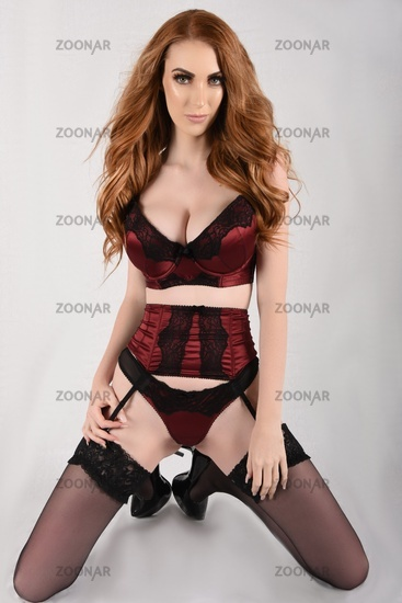Sexy, Tall, slim, busty Redhead dressed in sexy red Underwear