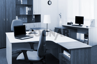 workplaces with computers in modern office