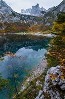 Picturesque Hinterer Gosausee lake, Upper Austria. Autumn Alps mountain lake with clear transparent water and reflections. Dachstein summit and glacier in far.