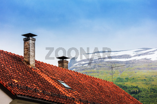 tile roof with chimneys and antenna