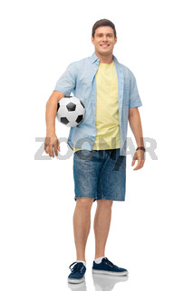 smiling young man with soccer ball