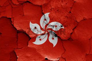 flag of Hong Kong painted on cracked wall
