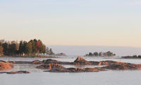 Rock formations and trees on a autumn morning in Vita Sannar, Sweden.