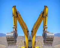 Reflection of an excavator facing away from the center of the symmetrical image