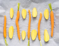 carrots and potatoes on parchment paper