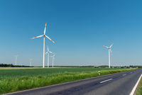 Wind turbines and a country road seen in Germany