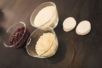 Ingredients for cranberry macaroons in small bowls
