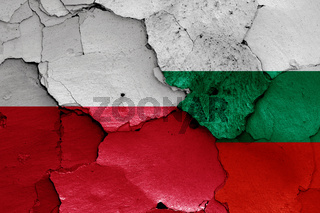flags of Poland and Bulgaria painted on cracked wall
