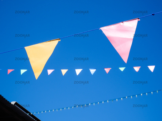 Pennant flag strings, Festival and Fair Decoration Party, Triangle flags against blue sky.