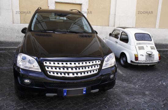 Parking: small car next to large car
