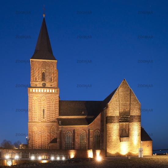 illuminated church St Martinikirche in evening light, Emmerich, Lower Rhine, Germany, Europe