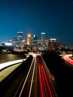 Light trails from cars going in and out of the city of Minneapolis