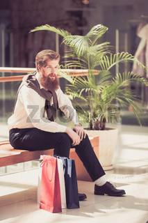 Male customer with shopping bags