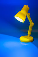Desk lamp on blue