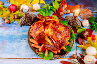 Delicious baked chicken on Thanksgiving diner to serve table close-up