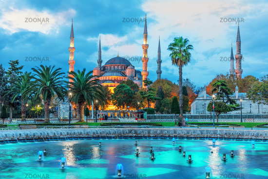 The Sultan Ahmet Mosque and the fountain in the blue shadows of sunrise, Istanbul