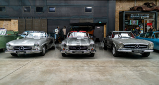 Sports cars Mercedes-Benz 190SL (left and centre) and Mercedes-Benz 280SL (right) stand in a row.