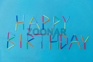 words happy birthday made of candles on blue
