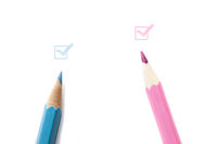 Light blue and pink pencils with matching colored checkboxes on white background for boy or girl announcement card