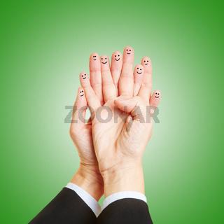 Finger mit Gesicht als Teamwork Konzept