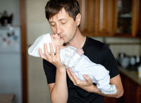 Infant boy in the arms of dad