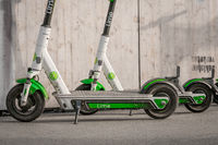 Electric E scooter , escooter or e-scooter of the ride sharing company LIME on sidewalk