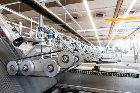 Folding Machine Output Hopper Stacks Wheels Closeup Industrial Machine Printing Industry